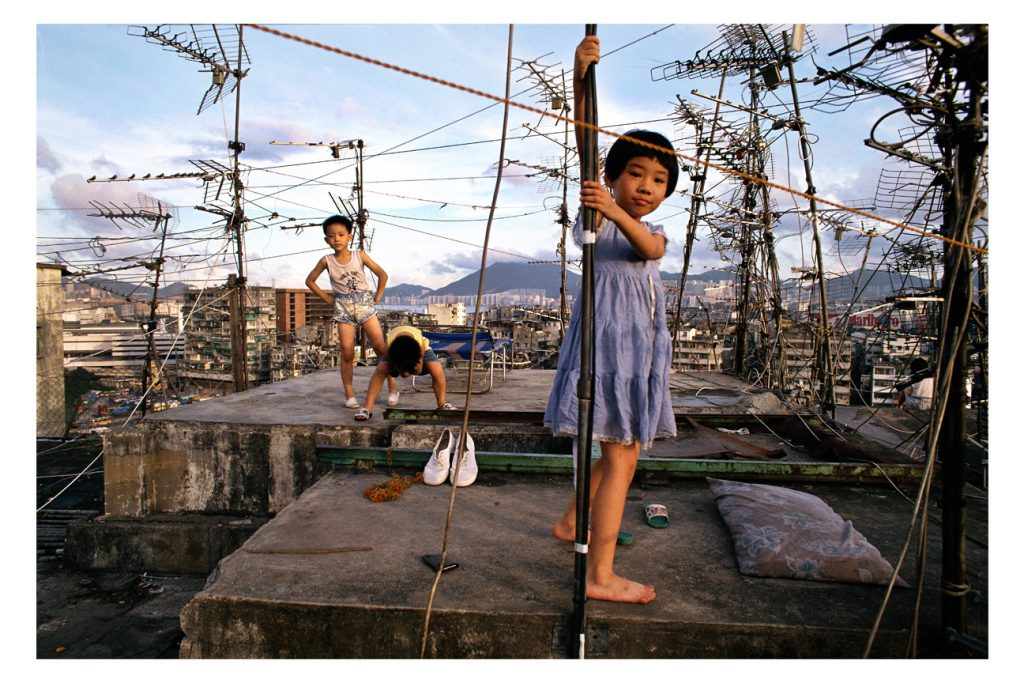 "Greg Girard, ""Kowloon Walled City, Children on Rooftop"", 1989, 11 x 14 inches, Framed, archival pigment print 1 of 20. Estimate: $425"